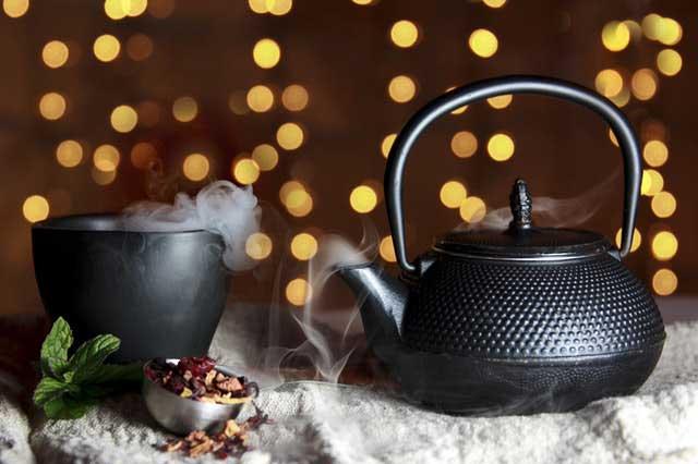 a pot of tea and cup