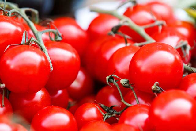 a basket of tomatoes that is good for the brain